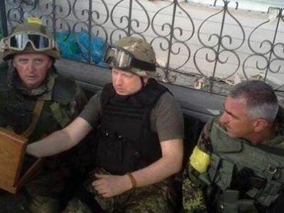 "Photo taken on the outskirts of Slavyansk, at the HQ of Ukrainian ""antiterrorist operation"" command. Jerzy Dziewulski (left) and Alexander Turchinov (center)."