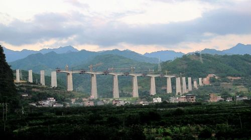 The Guiyang–Guangzhou High-Speed Railway under construction in Yangshuo, Guangxi in August 2013. This line traverses 270 caves and 510 valleys in the karst landscape of southwest China.[91] Bridges and tunnels consist of 83% of this line's total length of 857 km, including 92% in Guizhou Province.[91] Travel time by train between Guizhou and Guangzhou was reduced from 20 hours to 4 hours. Wikipedia
