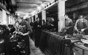 Jewish slave workers in striped uniforms work in a Nazi ammunition factory near Dachau concentration camp during World War II | Daily Mail