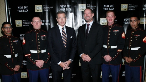 NBC Nightly News anchor Brian Williams poses with Super Bowl Champion Football Coach Bill Cowher and the USMC Color Guard at the Iraq and Afghanistan Veterans of America Annual Heroes Gala in November 2010 | Joe Kohen/Getty Images for IAVA