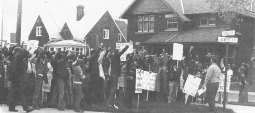 Demonstration at courthouse in Waterloo, May 1977, to denounce political persecution of CPC(M-L). The action was to support Comrade Hardial Bains and other comrades arrested February 23, 1977 on charges that were so bogus they were later thrown out of court. The hand of the political police in concocting the bogus charges was once again revealed but the media remained silent on that. (Click to enlarge)