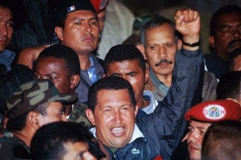 President Chávez raises a defiant fist after the people defeat the coup and he is released on April 14, 2002.