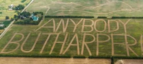 Brantford Farmer John Langs cut a message for Harper in his 46-acre rye field. Each letter is 100 metres high, and the words were first noticed by aerial photographer Geoff Grenville. (Click to enlarge)