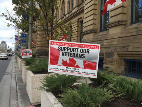 Veteran's signs condemning Harper government outside Prime Minister's Office, October 18, day before the federal election