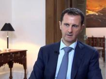 Bashar al-Assad speaking during an interview in Damascus broadcast by Khabar TV