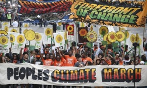 Peoples Climate March of more than 100,000 in New York, September 21, 2014. Such marches are being outlawed in France during the World Climate Conference this month. | John Minchillo/AP Images