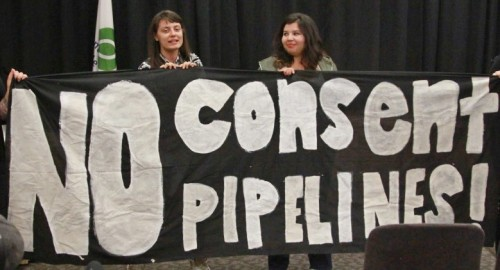 "Mohawk women take stage at Energy East Pipeline consultation meeting in Montreal, September 23, 2015, affirming that ""This is Kanien'ke, this is Mohawk Land and we are tired of occupation, we are tired of environmental disaster."""