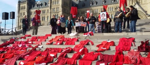 Allegations of police abuse of Indigenous women in Val D'Or are protested on Parliament Hill, November 3, 2015. The red dresses symbolize the demand for redress for those victimized.