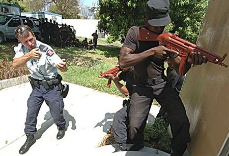 An RCMP officer training Haitian National Police (HNP) recruits in 2005. The HNP, notorious for its oppression of the people, had been disbanded by the Aristide government.