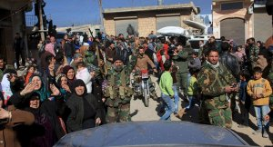 Residents of Nubul and al-Zahra along with soldiers of the Syrian Arab Army celebrate after the siege of their town was broken in the northern Aleppo countryside, Syri on February 4, 2016 | SANA /Reuters