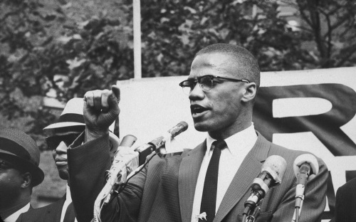 Malcolm X (1925 - 1965) at an outdoor rally, probably in New York City | Bob Parent/Hulton Archive/Getty Images)