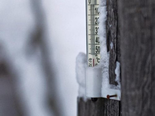 A thermometer shows a temperature around minus 55 degrees Celsius in the village of Tomtorin.