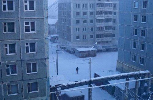 A man walks through a courtyard in Yakutsk.
