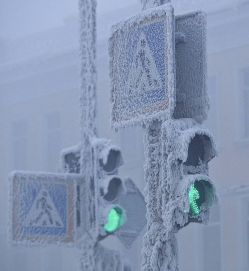 Traffic lights are seen covered in snow in Yakutsk.