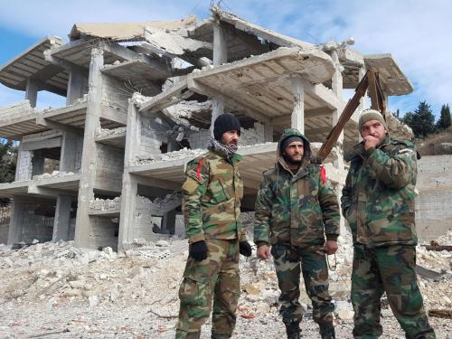 Pro-government Syrian forces in al-Rabiaa who have recently taken the town from rebels   AFP/Getty