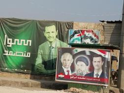 A poster in Nubl featuring Vladimir Putin, Bashar al-Assad and the Hezbollah leader Sayed Hassan Nasrallah (Nelofer Pazira)