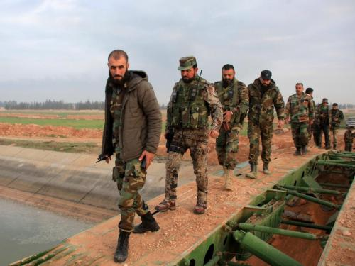 Syrian government forces cross a retractable military bridge on the outskirts of Aleppo   Getty Images
