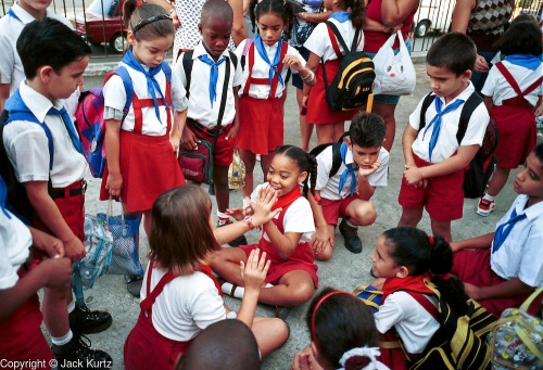 MARCH 19, 2001 - HAVANA, CUBA: Elementary school students play before the start of classes at a school in the Vedado section of Havana, Cuba, March 19, 2001. Cuba's education system is widely considered to be one of the best in the developing world and Cuba's illiteracy rate is among the lowest in the world. PHOTO BY JACK KURTZ WOMEN EDUCATION FAMILY CHILDREN