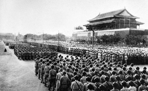 The land force of the Chinese People's Liberation Army marches through Tiananmen Square during the People's Republic of China's nation founding day parade on October 1, 1949.