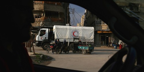 A Syrian Red Crescent truck, part of a convoy carrying humanitarian aid, is seen in Kafr Batna on the outskirts of Damascus on Feb. 23, 2016, during an operation in cooperation with the U.N. to deliver aid to thousands of besieged Syrians.