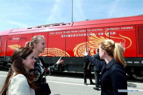 2018.04.27.People look at a new China-Europe freight train from Chengdu to Vienna at the Vienna South Freight Center in Vienna, Austria
