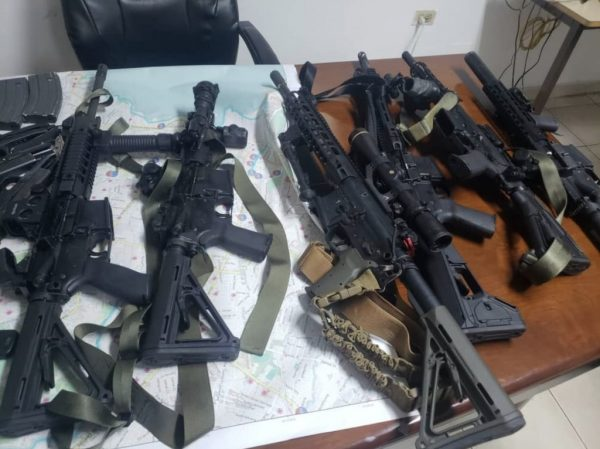 2019-02-18-at-10.48.04-AM.Seized weapons Haiti