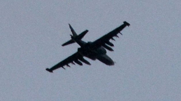 2014.The SU-25 attack aircraft over the railway station in Donetsk